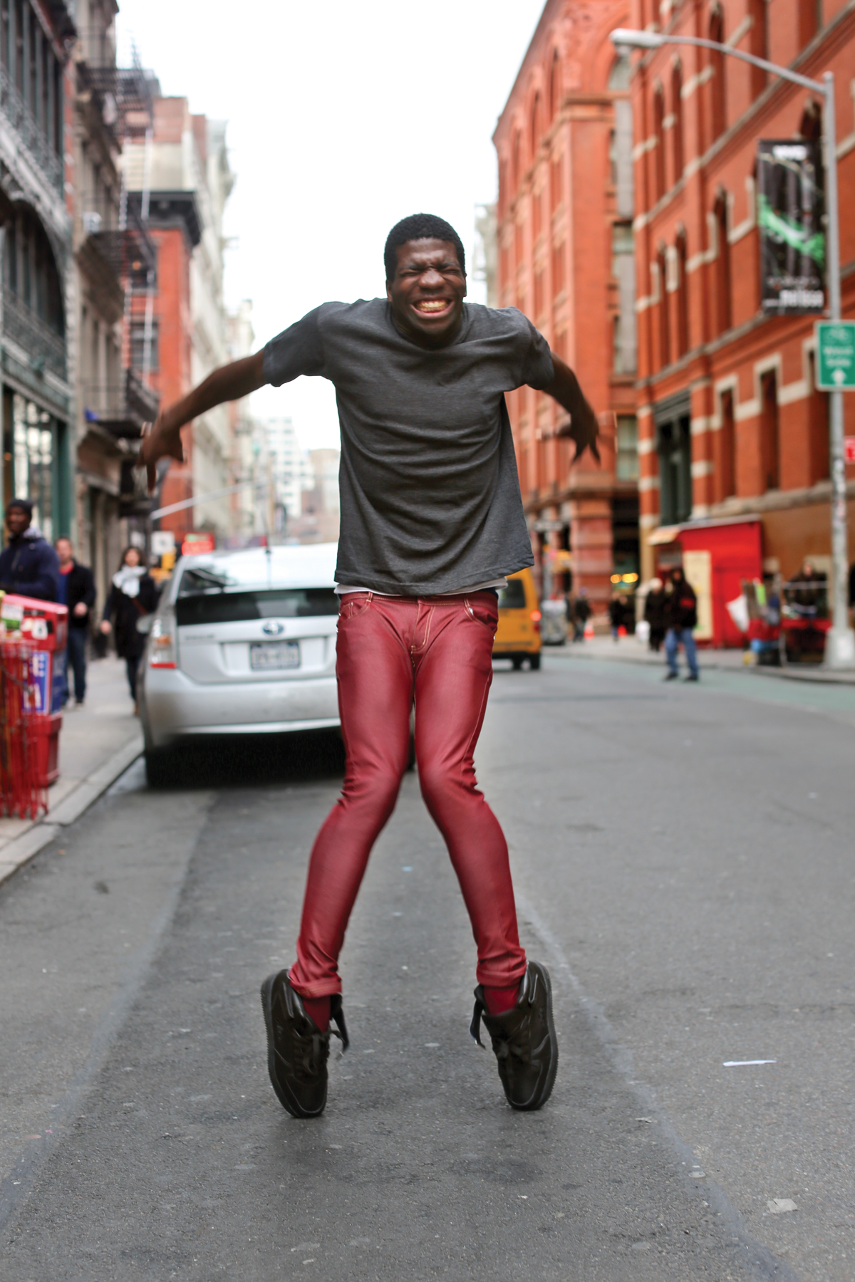 "'This guy was dancing for tips on the sidewalk. I asked him to try and put all his skill into a single move, and this is what I got.' Brandon Stanton, ""Humans of New York"""